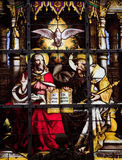 Trinity. Glass window, depicting Father, Son and Holy Spirit Royalty Free Stock Image