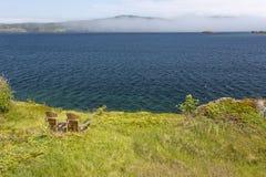 Trinity bay, incoming fog, Newfoundland. Trinity bay, incoming fog, two chairs, Newfoundland stock images