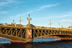 Trinity bridge across the river Neva, Russia. Trinity bridge across the river Neva, St. Petersburg, Russia,. Blue sky with clouds Royalty Free Stock Images