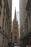 Trinity Church at the intersection of Wall street and Broadway in Manhattan, NYC Stock Photography