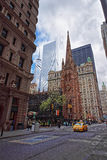 Trinity Church at the intersection of Wall street and Broadway Stock Images
