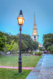 Trinity Church Park at Night. Historic Trinity Church at night in Newport, Rhode Island, USA. This is an HDR image showing a park lamp in front of a white church Stock Photography