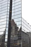 Trinity Church Reflection on a Modern Glass Skyscraper from Boston downtown in Massachusettes State of USA Royalty Free Stock Image