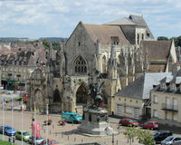 View of Falaise, France. Trinity Church and William the Conqueror square in Falaise, France, which is the birthplace of the Norman King William Stock Image