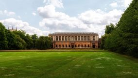 Green lawn with medieval building in background Royalty Free Stock Image