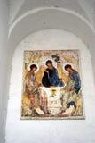 Trinity icon on a church facade. Kremlin in Kolomna, Russia. Color photo. KOLOMNA, MOSCOW REGION, RUSSIA - JANUARY 02, 2017: Trinity icon on a church facade Stock Photography