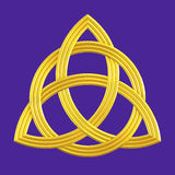 Trinity knot gold Triquetra symbol. Golden Christian or Celtic Trinity knot isolated with purple background. A blessing sign meaning unity of Father, Son & Holy Stock Photo