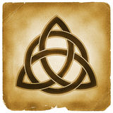 Trinity knot symbol old paper. Christian Celtic Triquetra sign marked on weathered papyrus. Blessing knot charm. Father Son Holy Spirit religious symbol Stock Photography