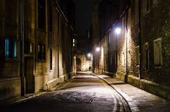 Trinity Lane by night, Cambridge, United Kingdom. An empty Trinity Lane by night illuminated by the historical lanterns, Cambridge, United Kingdom Royalty Free Stock Photos