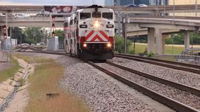 Trinity Railway Express Train in Dallas, USA. TRE (Trinity Railway Express) train approaching the station in Dallas City. April 18, 2016 in Dallas, Texas, United stock footage