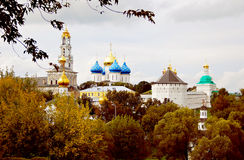 Trinity Sergius Lavra in autumn. Church Domes in Trinity Sergius Lavra, Sergiev Posad, Russia. UNESCO World Heritage Site. Autumn trees Stock Photo