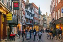 Trinity street with shops, cafes and lots of people Stock Image