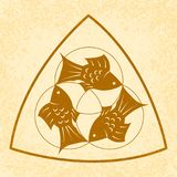 Trinity Sunday. Christian holiday. Three fish, located symmetrically. On a Beige grunge background. Trinity Sunday. The concept of a religious Christian holiday Royalty Free Stock Image