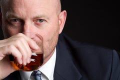 Trinkender Geschäftsmann Stockfotografie