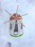 Trinket wind mill. On the snow Stock Photography