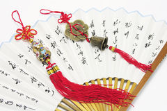 Trinkets and Chinese Fans. Close Up of Trinkets and Chinese Fans stock photography