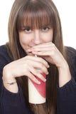 Trinkmilch der Frau mit einem Stroh stockfotos