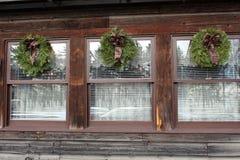 Trio av fönster med feriekranar Fotografering för Bildbyråer