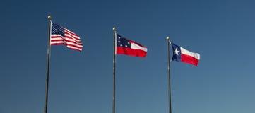 Trio av flaggor Arkivbilder