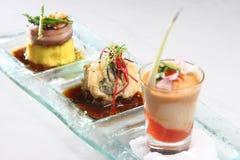 Trio av gourmet- huvudrätter, asiatisk mat royaltyfri bild