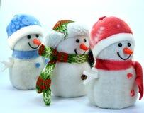 Trio av snögubben Arkivfoton