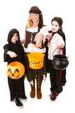 Trio av ungar på Halloween Arkivbild