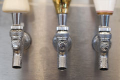 Trio of Beer Tap Spouts Stock Photography