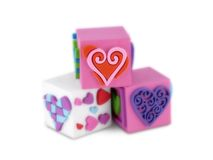 Trio Blocks of Hearts. Three foam blocks with pink, red and purple hearts. Soft focus on all but red heart (in sharp focus). Concept: Building blocks of love stock photos