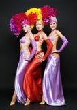 Trio bonito em trajes do estágio imagens de stock
