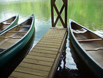 Trio of canoes await in boathouse in North Carolina mountains Stock Images