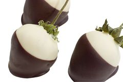 A trio of chocolate covered strawberries. A trio of black and white chocolate covered strawberries Stock Image