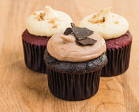 Trio of chocolate and red velvet mini cupcakes Stock Photo