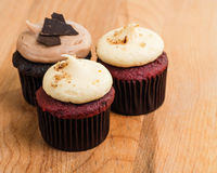 Trio of chocolate and red velvet mini cupcakes Royalty Free Stock Photos