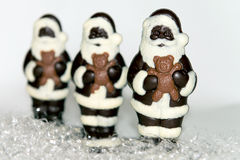 Trio of Chocolate Santas on Snow Royalty Free Stock Photography