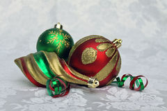 Trio of Christmas Ornaments. Three red, green and gold Christmas ornaments Royalty Free Stock Photos