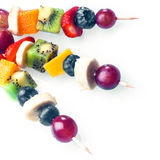 Trio of colourful tropical fruit kebabs royalty free stock photo