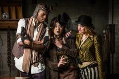Trio de Steampunk com telefone Imagem de Stock