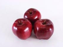 Trio del Apple su bianco Immagine Stock