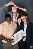 Trio des adultes impairs Photo stock
