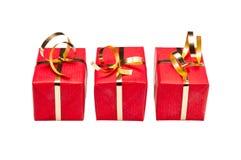 Trio des Rotes und der Goldweihnachtsgeschenkboxen lizenzfreies stockfoto