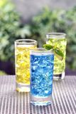 Trio Drinks and juices. Setting. Outdoor shot Royalty Free Stock Photo
