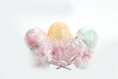 A trio of eggs. Three decorative eggs against a white background Royalty Free Stock Image