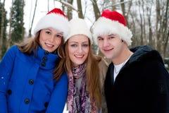 Trio enjoying a christmas day outside Stock Photography