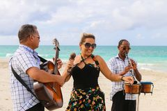 Trio ensemble performing on the beach, Cuba, Varadero Royalty Free Stock Image