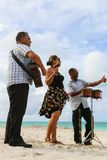 Trio ensemble performing on the beach, Cuba, Varadero Royalty Free Stock Photo