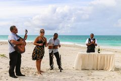 Trio ensemble performing on the beach, Cuba, Varadero Royalty Free Stock Photography