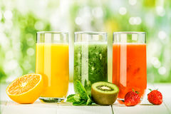 Trio of fresh healthy fruit juice blends Stock Photography