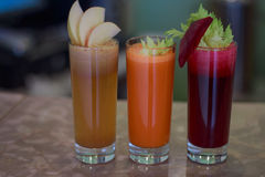 Trio freshly squeezed juice. Sweet fresh from beets with celery , caroot and apples stock photo