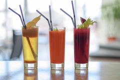 Trio freshly squeezed juices. Sweet fresh from beets with celery , carrot and apples royalty free stock images