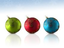 Trio Glass Ornament. Colorful trio of glass Christmas ornaments; isolated with reflection stock photos